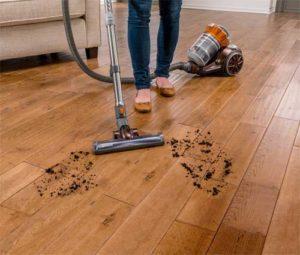 Cleaning bare floor using the best hardwood floor vacuum